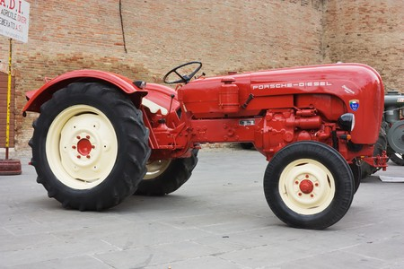 old tractors: FORLIMPOPOLI, ITALY - OCTOBER 10: Exhibition of old tractors: vintage tractor   Porsche exhibit at Autunno forlimpopolese on october 10, 2010 in   Forlimpopoli, Italy. Editorial