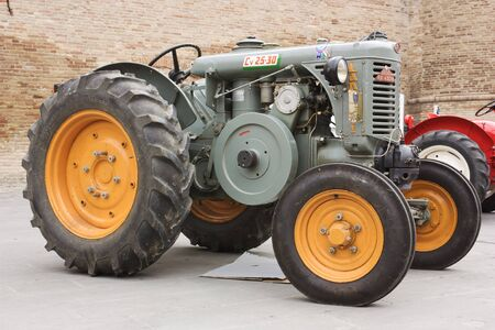 old tractors: FORLIMPOPOLI, ITALY - OCTOBER 10: Exhibition of old tractors: vintage tractor    exhibit at Autunno forlimpopolese on october 10, 2010 in   Forlimpopoli, Italy. Editorial