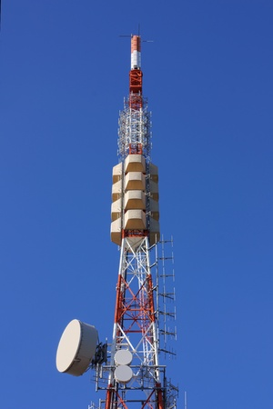 telephonic: dtt, digital terrestrial radio television, repeater relay station, pylon with aerials for transmission