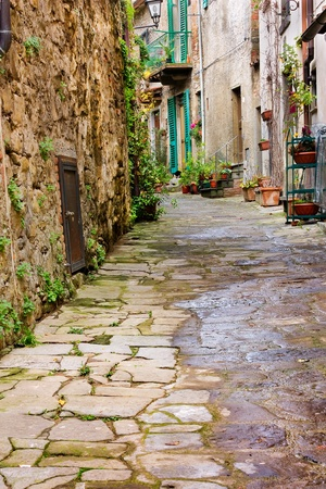 tuscan: old narrow alley in tuscan village - antique italian lane - tuscany, italy