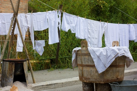 old underwear hanging out to dry - hang out the washing - clothes-line with ancient linen - ancient vat of laundry