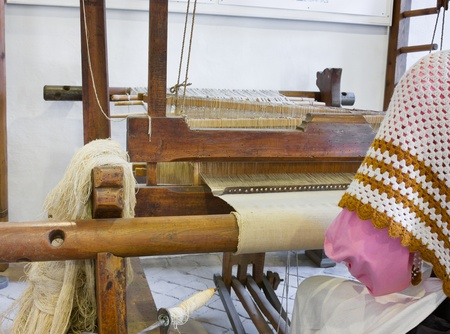 old loom, weaving home made fabric, textile work, woven handicraft, ancient canvas manufacturing photo