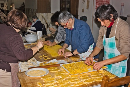 FORLI, ITALY - JANUARY 30: traditional italian cuisine, women making pasta and croutons on january 30 2011 at Sapeur fair of the typical Italian food in Forli, Italy