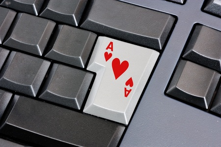 ace of hearts on computer keyboard, on-line search of lover, love meeting online, seek encounter on the web, find a marriage partner on internet site, card symbol of desire on enter key  photo