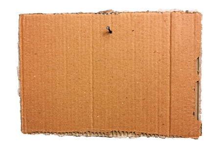 pasteboard: empty signboard of ripped cardboard sheet, hanging with nail, blank notice of torn corrugated pasteboard