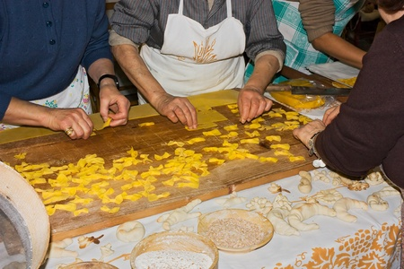 FORLI, ITALY - JANUARY 30: traditional italian cuisine, women making dough and croutons on january 30 2011 at Sapeur fair of the typical Italian food in Forli, Italy