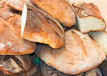 leavening: large pieces of italian bread at natural leavening, exposure of bakery at market, traditional product of italy