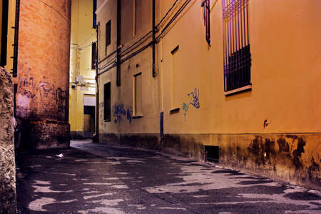 slum: grunge dark alley - slums of the city - squalid dirty corner of street - italian decadent distressed old town - street at night - urban decay