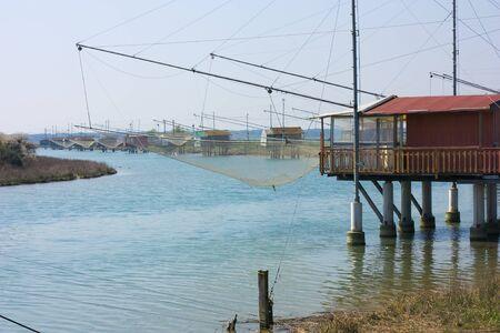 fishing huts - shacks with net on the river of ravenna, italy Stock Photo - 9242184
