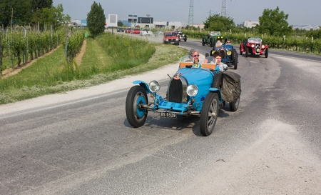FORLI', ITALY - MAY 13: the mille miglia historical race, on May 13 2011 in Forli', Italy - classic cars traveling 1000 miles in memorial of the old italian rally. In the first position the Bugatti Type 37 A (1927) Stock Photo - 9522000