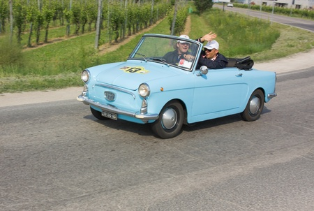"""FORLI', ITALY - MAY 13: unidentified drivers in Autobianchi 500 Bianchina cabriolet in stage Bologna-Roma of the """"Mille miglia"""" historical race for classic cars, on May 13 2011 in Forli', Italy"""