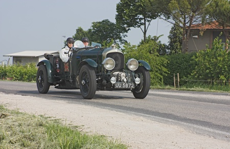 FORLI, ITALY - MAY 13: Franz-Josef Paefgen drives a Bentley 4 12 litre supercharged (1929) in stage Bologna-Roma of the Mille miglia historical race for classic cars, on May 13 2011 in Forli, Italy