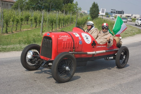 mille: FORLI, ITALY - MAY 13: unidentified drivers in old Fiat transit during the stage Bologna-Roma of the Mille miglia historical race for classic cars, on May 13 2011 in Forli, Italy