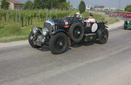 FORLI, ITALY - MAY 13: Geoffrey Ford and Richard Ford drives a Bentley 4½ Litre Supercharged (1930) in stage Bologna-Roma of Mille miglia the famous race for old cars, on May 13 2011 in Forli, Italy