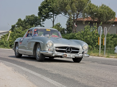 FORLI, ITALY - MAY 13: C. Kramer and J. Weisheit drives a Mercedes-Benz 300 SL W198-I (1955) in stage Bologna-Roma of the Mille miglia historical race for classic cars, on May 13 2011 in Forli, Italy