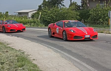 scuderia: FORLI, ITALY - MAY 13: D. Gianaroli and F. Buscaroli drives a Ferrari 430 Scuderia in stage Bologna-Roma of the Ferrari Tribute to Mille Miglia, historical italian race, on May 13 2011 in Forli, Italy Editorial