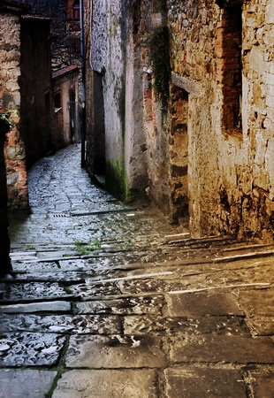 grunge dark alley with staircase at night in the old tuscan village photo