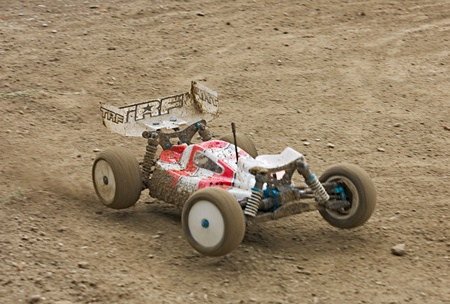 controlled: FORLI, ITALY - JULI 24: a rc model car in italian championship 110 buggy 4 wd, on Juli 24 2011 in Forli, Italy - off road race for radio controlled car with electric engine