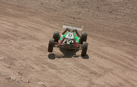 FORLI, ITALY - JULI 24: a rc model car in italian championship 110 buggy 4 wd, on Juli 24 2011 in Forli, Italy - off road race for radio controlled car with electric engine