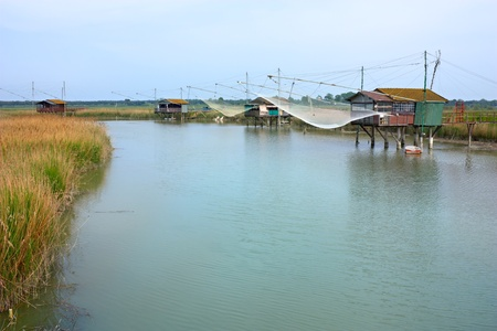 fishing huts - shacks with net on the river of ravenna, italy Stock Photo - 10419797