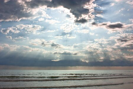 morning sun rays through clouds - dramatic landscape of cloudy sky over the sea Stock Photo - 10419796