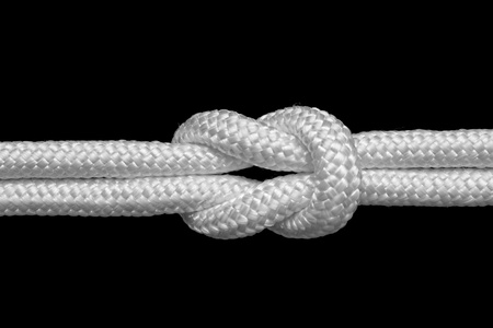 nylon string: reef or square knot for join two ropes, isolated on black
