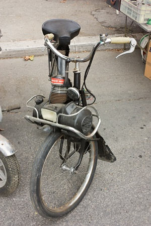 old french moped Velo Solex, motor bicycle with the engine on the front wheel, at vintage festival