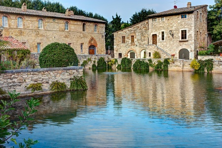 tuscan house: old thermal baths in the medieval village Bagno Vignoni, Tuscany, Italy -  spa bassin in the antique italian town