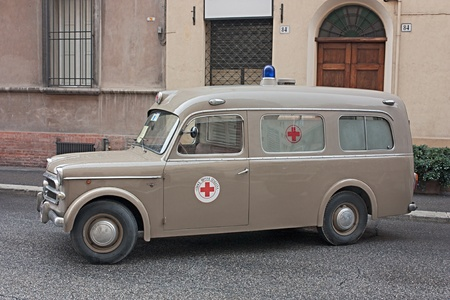 """FAENZA, ITALY - NOVEMBER 6: old italian ambulance Fiat 1100 (year 1957) exposed at """"Fiera di San Rocco"""" that hosts historical recalling, and various exposition, on November 6, 2011 in Faenza, RA, Italy."""