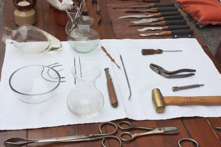 old surgical tools used by dentist - antique medical equipment photo