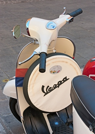IMOLA (BO) ITALY - OCTOBER 8: vintage italian scooter with spare wheel exposed by the Vespa club Imola at old cars and motorcycle meeting Luigi Musso Historic Gran Prix  on October 8, 2011 in Imola (BO) Italy