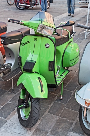 gran prix: IMOLA (BO) ITALY - OCTOBER 8: green italian scooter, vintage sports, exposed by the Vespa club Imola at old cars and motorcycle meeting Luigi Musso Historic Gran Prix  on October 8, 2011 in Imola (BO) Italy Editorial