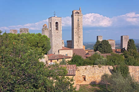landscape of medieval town in tuscany, Italy - towers of San Gimignano, antique italian village photo