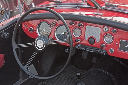 bygone: classic car interior; dashboard of an old MG roadster exposed at festival of vintage cars Mostrascambio 2011 on SEPTEMBER 4, 2011 in Gambettola (FC) Italy Editorial