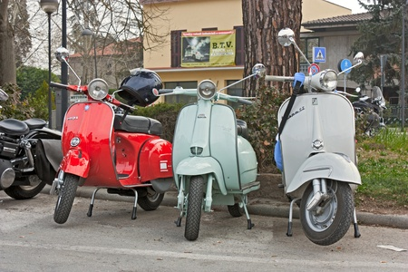 vintage italian scooters Vespa and Lambretta at motorcycle rally Motosalsicciata 2012 on March 25, 2012 in Voltana di Lugo (RA) Italy