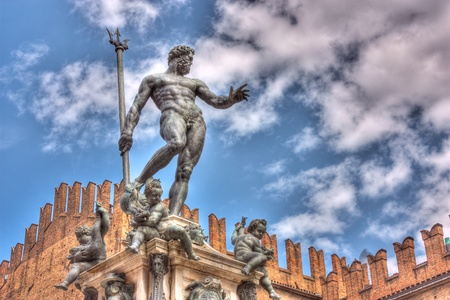 bologna: the antique statue of Neptune, the god of water and the sea in roman mythology and religion, an famous monument of the italian Renaissance, in Bologna, Italy - hdr image