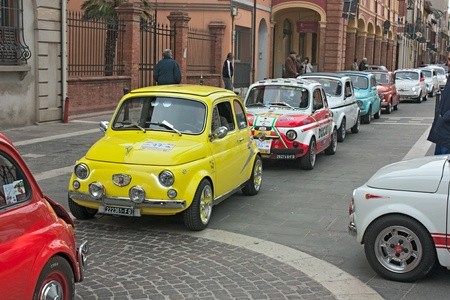 old italian small cars at  Fiat 500 day of Forlimpopoli, rally of vintage economy car Fiat 500, on April 1, 2012 in Forlimpopoli (FC) Italy