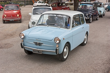 vintage small car Autobianchi 500 Bianchina at  Fiat 500 day of Forlimpopoli, rally of old economy cars Fiat 500, on April 1, 2012 in Mercato Saraceno (FC) Italy