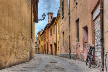 old italian alley - view of ancient narrow street in Italy with bicycle, lamp and bell tower