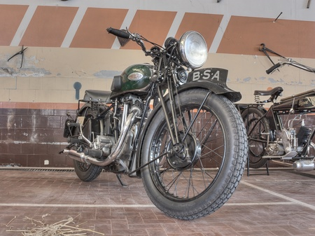 old restored motorbike BSA W35-7 (1935) exposed at Agriolo, festivals of old motorcycle and agricultural machinery, on April 15, 2012 in Riolo Terme (RA) Italy