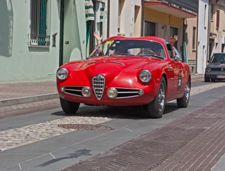 reenactment re enactment: a vintage car Alfa Romeo 1900 C Super Sprint (1957) in classic cars rally Mille Miglia 2012, re-enactment of the old italian  race (1927-1957) on May 18, 2012 in Gatteo (FC) Italy