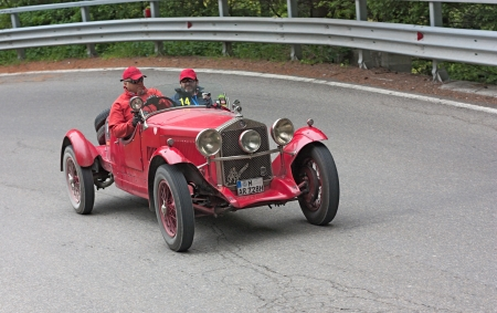 reenactment re enactment: an old racing car Alfa Romeo 6C 1500 Sport (1928) runs in rally Mille Miglia 2012, re-enactment of the old italian endurance race (1927-1957) on May 19, 2012 in Passo della Futa (FI) Italy Editorial