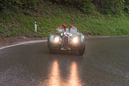 an old racing car JAGUAR CXK 120 Alu (1950) runs in rally Mille Miglia 2012, re-enactment of the old italian endurance race (1927-1957) on May 19, 2012 in Passo della Futa (FI) Italy