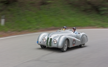 an old racing car BMW 328 Mille Miglia Roadster (1939) runs in rally Mille Miglia 2012, re-enactment of the old italian endurance race (1927-1957) on May 19, 2012 in Passo della Futa (FI) Italy