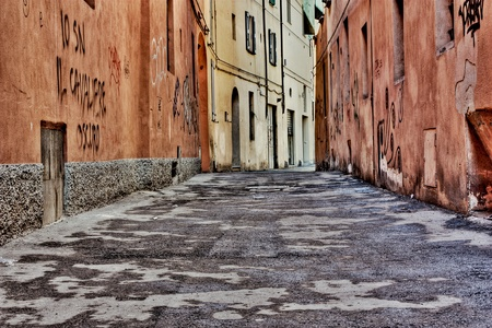 narrow: narrow alley in the old town - dirty street in the decadent old town - urban decay Stock Photo