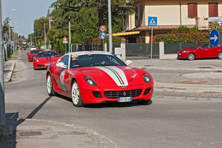 unidentified drivers in red sports car Ferrari at the Ferrari Tribute to Mille Miglia, the historical italian race, on May 18, 2012 in Gatteo (FC) Italy