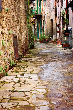 old narrow alley in tuscan village - antique italian lane - tuscany, italy  photo