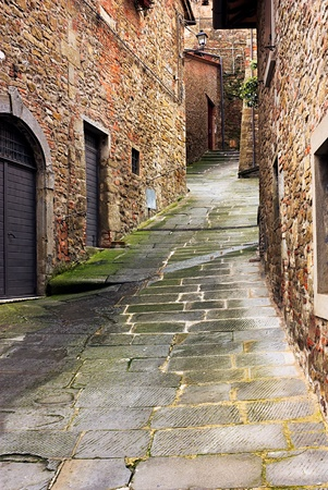 old narrow alley in tuscan village - antique italian lane in Tuscany, Italy  photo