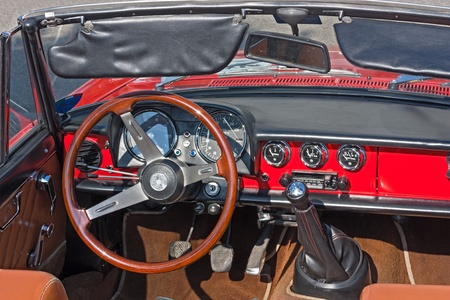 bygone: vintage car interior; dashboard of an old Alfa Romeo 1300 Spider at festival of vintage cars 10° Rally of Roman Centuriae on june 2, 2012 in Cesena (FC) Italy