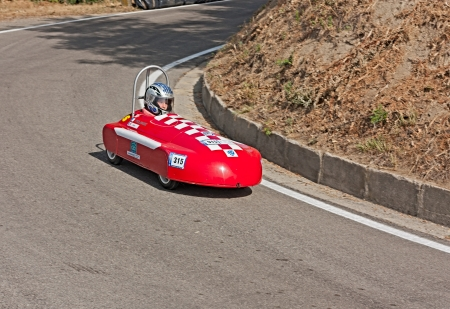 young girl race on a soap box car at european championship speed down on July 28, 2012 in Predappio Alta, FC, Italy